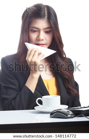 Portrait of relaxed business woman holding a cup of coffee