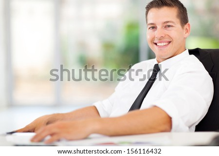 portrait of relaxed office worker - stock photo