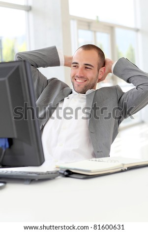 Portrait of relaxed salesman in office - stock photo