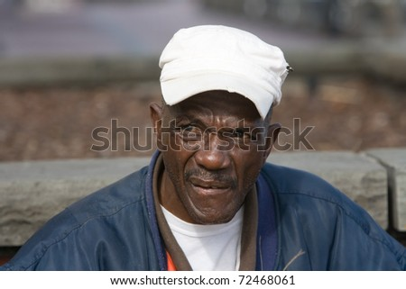 Portrait of retired African American man outside during the daytime - stock photo
