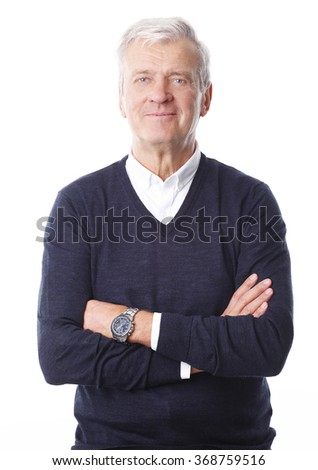 Portrait of retired professional man with arms crossed standing at isolated background.  - stock photo