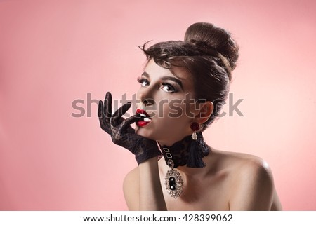 Portrait of retro - a girl with gloves - stock photo