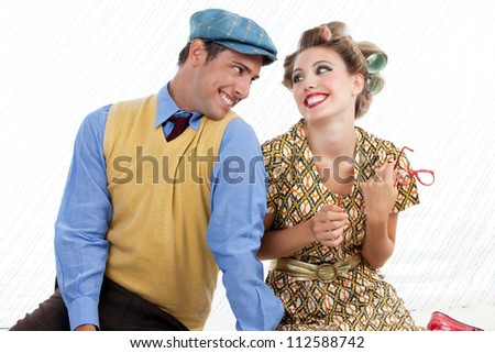 Portrait of retro young couple looking and smiling at eachother