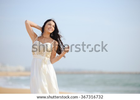 Portrait of romantic beautiful sexy elegant female on the beach background