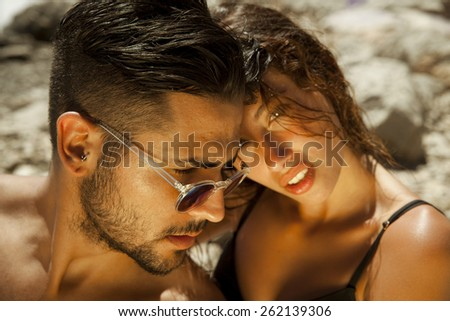 Portrait of romantic couple on the beach. summer style, outdoors shot - stock photo