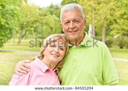 Portrait of romantic elderly couple outdoors. - stock photo