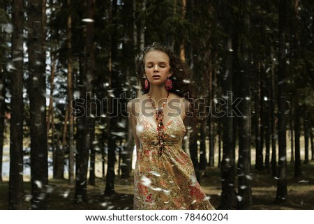 Portrait of romantic woman in fairy forest - stock photo