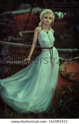 Portrait of romantic woman in forest - stock photo