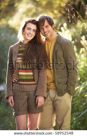 Portrait Of Romantic Young Couple In Autumn Landscape - stock photo