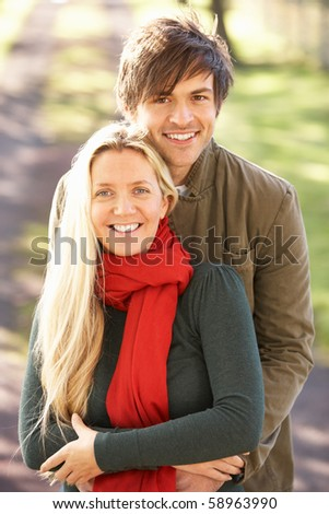 Portrait Of Romantic Young Couple In Autumn Park - stock photo