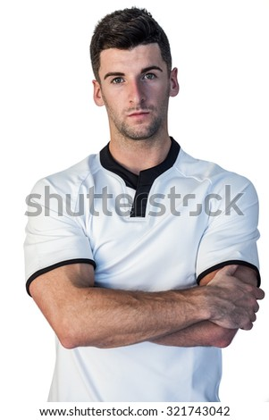 Portrait of rugby player with arms crossed against white background