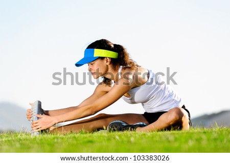 portrait of runner stretching and warming up for exercise and fitness healthy lifestyle - stock photo