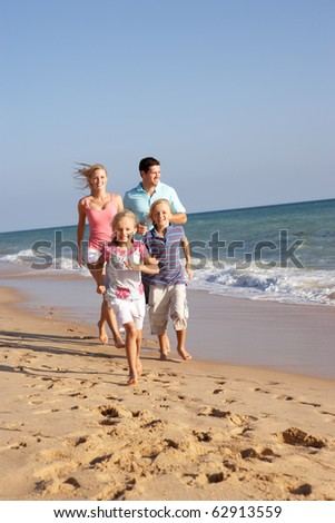 Portrait Of Running Family On Beach Holiday - stock photo