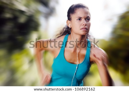 portrait of running healthy fitness woman training for marathon outdoors in alleyway. vitality lifestyle exercise athlete. motion blur speed sprint. - stock photo