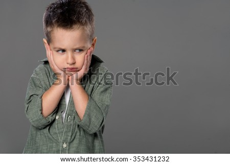 Portrait of sad and angry boy   - stock photo