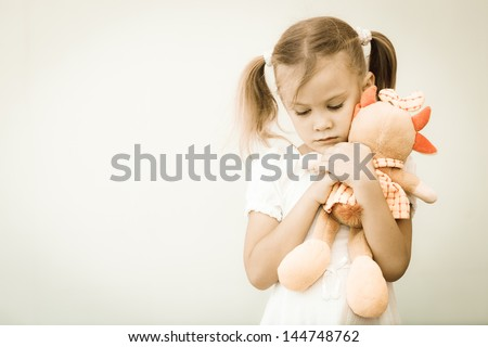Portrait of sad child - stock photo