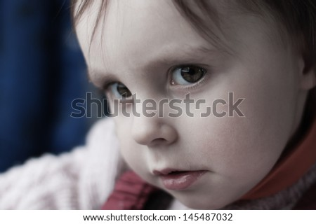 Portrait of sad child close-up.