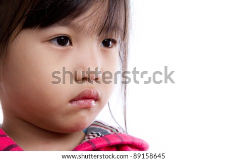 Portrait of sad child over white background - stock photo