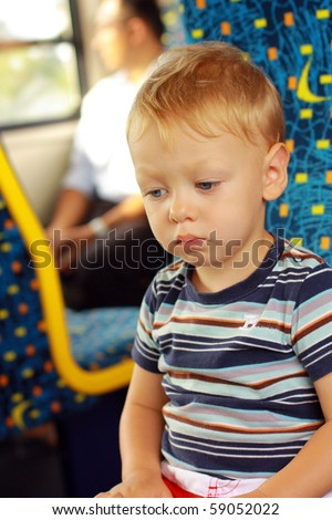 Portrait of sad little boy in the train