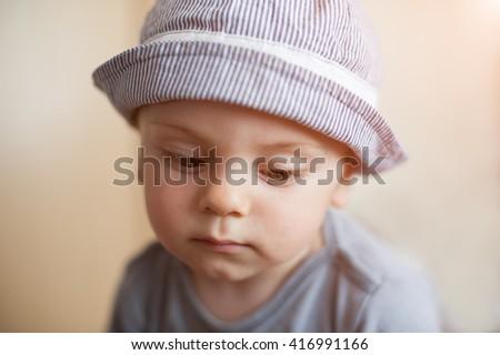 Portrait of  sad little boy looking down - stock photo