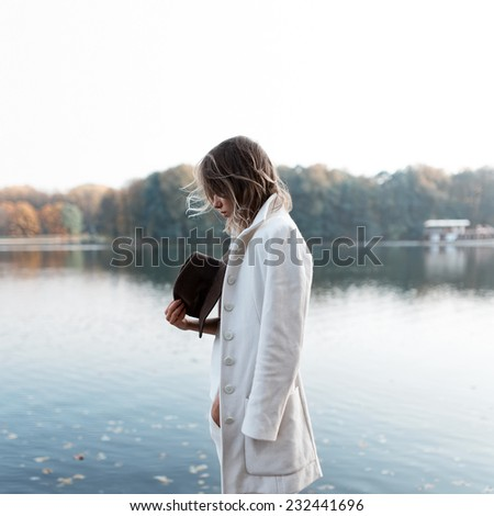 Portrait of sad lonely girl in the wind profile - stock photo