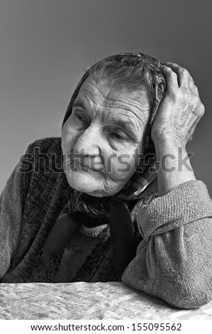 Portrait of sad lonely pensive old senior woman. Dreaming the past.  - stock photo