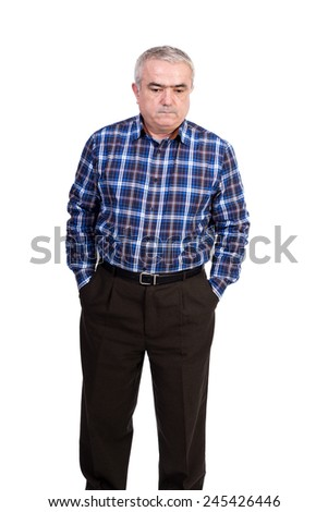 Portrait of sad senior man with hands in his pockets looking down isolated over white background - stock photo
