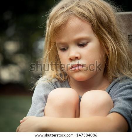 portrait of sad shaggy little girl - stock photo
