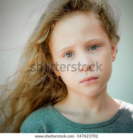 portrait of sad shaggy little girl - stock photo