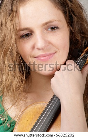 Portrait of sad smiling woman with violin