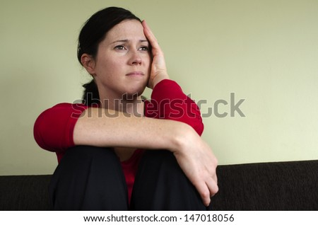 Portrait of sad young woman - concept photo - stock photo