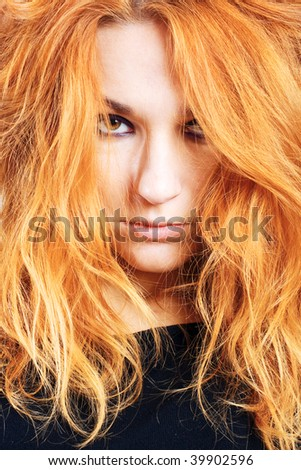Portrait of sadness beauty girl with red hairs