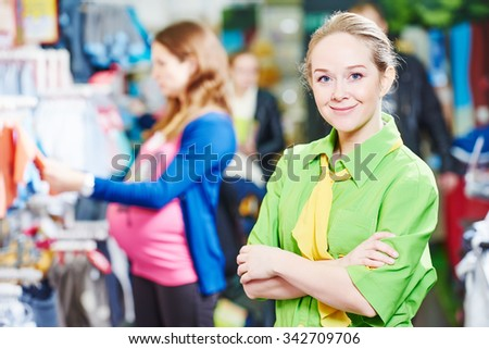 Portrait of sales assistant or seller in baby product shoppping center - stock photo