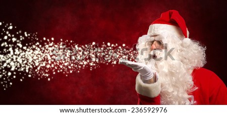 Portrait of Santa Claus blowing snow - stock photo