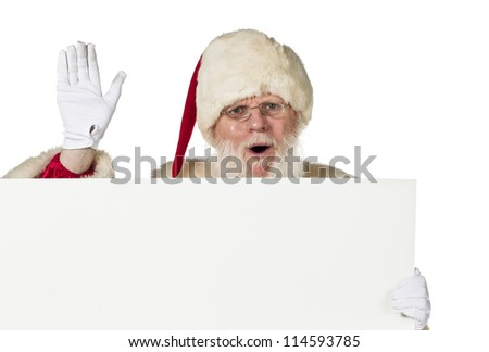 Portrait of Santa Claus holding a blank billboard on white background