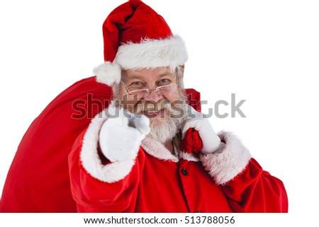 Portrait of santa claus holding christmas bag and gesturing against white background