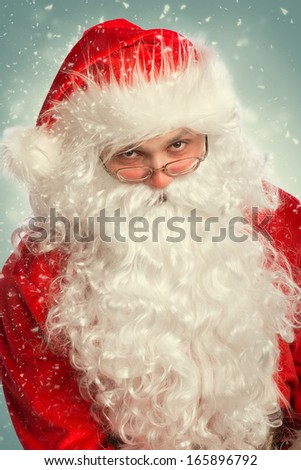 Portrait of Santa Claus in a snow - stock photo