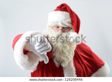 portrait of santa clause with thumb down - stock photo
