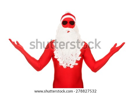 Portrait of santa in latex clothing showing copyspace. - stock photo