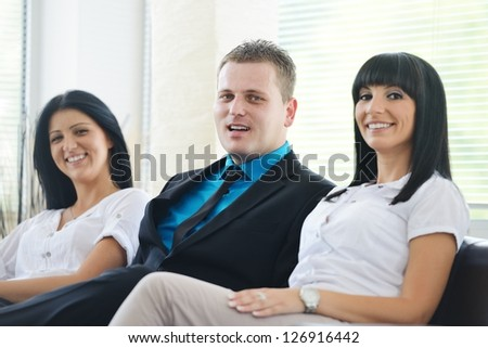 Portrait of satisfied business partners laughing during conversation - stock photo