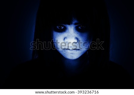 Portrait of scary girl staring at cameras - stock photo