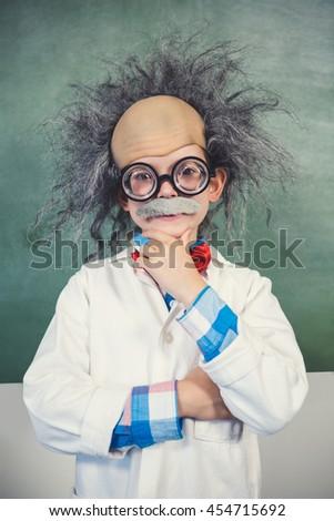 Portrait of schoolgirl pretending to be a teacher in classroom at school - stock photo