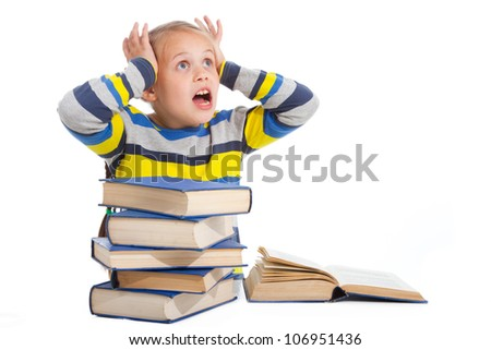 Portrait of schoolgirl with horror looking at pile of books on isolated white background - stock photo