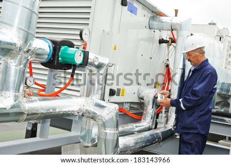 Portrait of senior adult smiling ventilaation electrician builder engineer - stock photo