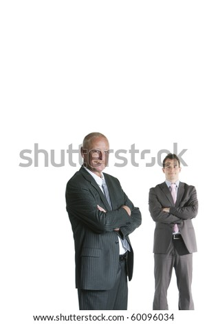 Portrait of senior businessman and younger businessman standing against white background - stock photo