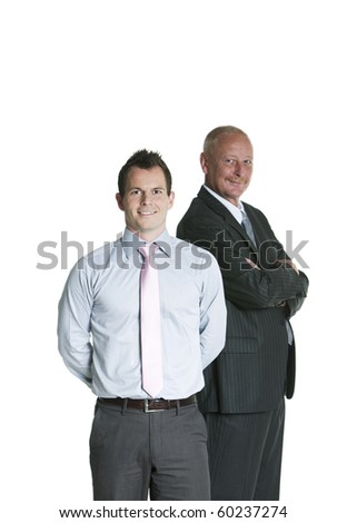 Portrait of senior businessman and younger businessman standing against white background