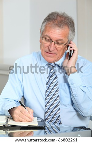 Portrait of senior businessman in office - stock photo