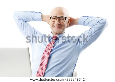 Portrait of senior businessman relaxing in front of computer. Isolated on white background.  - stock photo