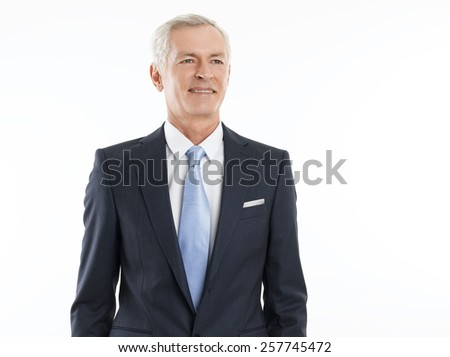 Portrait of senior businessman standing against white background. Business people.  - stock photo