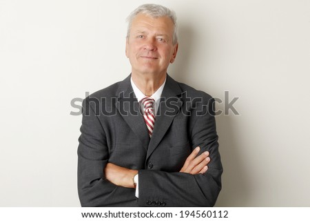 Portrait of senior businessman standing at office.  - stock photo